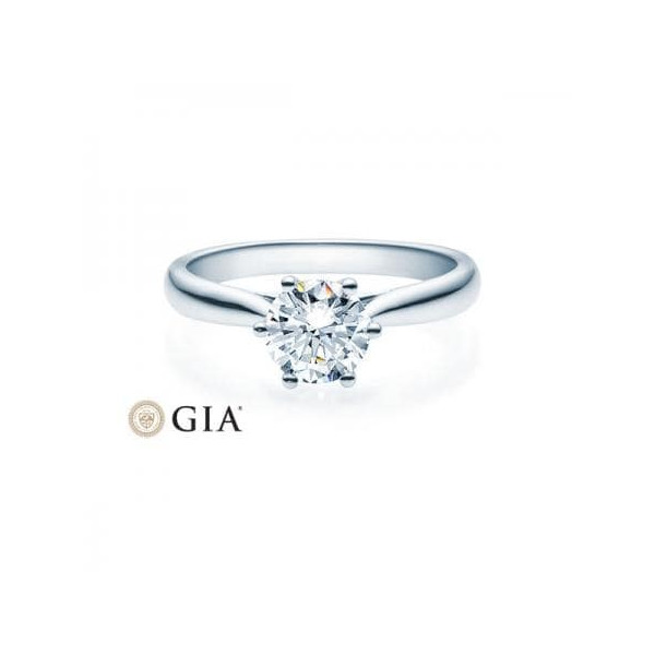 Solitario en oro amarillo con diamante 0,100 ct.  - 1